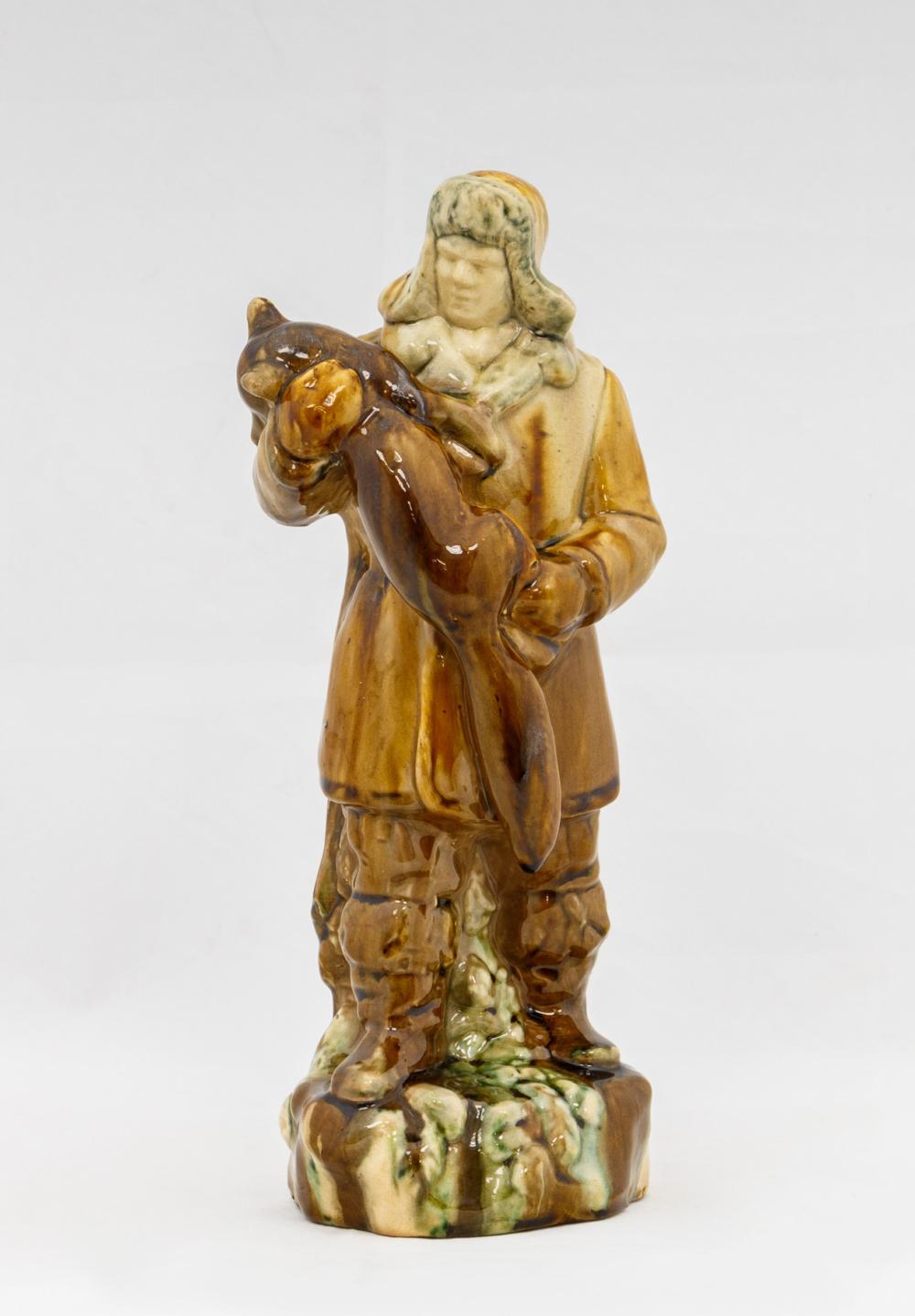 Скульптура «Охотник с лисой»
