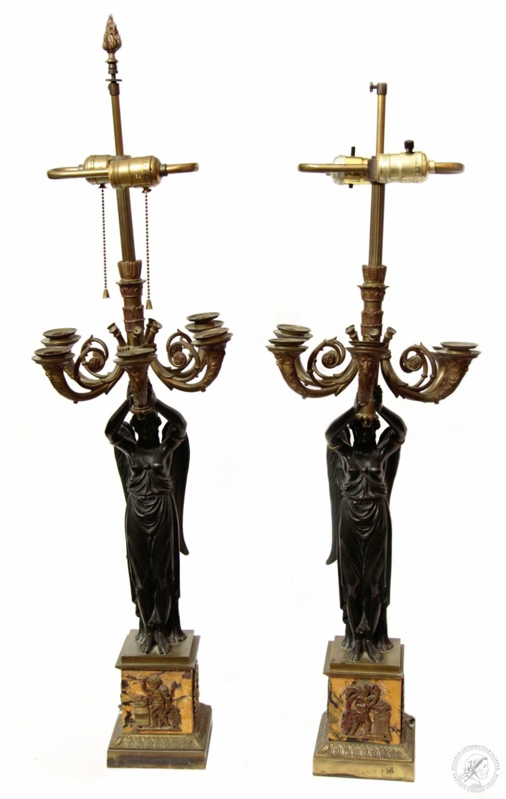 Парные канделябры на пять свечей с крылатыми патинированными фигурами