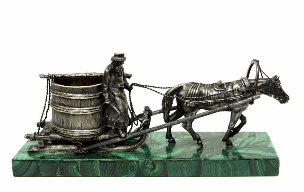 Посеребрённая бронзовая фигура на малахитовой подставке